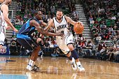 Deron Williams of the Utah Jazz drives to the basket past Rodrique Beaubois of the Dallas Mavericks at EnergySolutions Arena on February 1 2010 in...