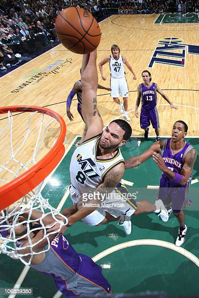 Deron Williams of the Utah Jazz goes for the dunk against the defense of the Phoenix Suns at EnergySolutions Arena on October 28 2010 in Salt Lake...