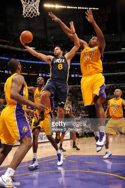 Deron Williams of the Utah Jazz goes up for a shot against Andrew Bynum of the Los Angeles Lakers at Staples Center on January 25 2011 in Los Angeles...