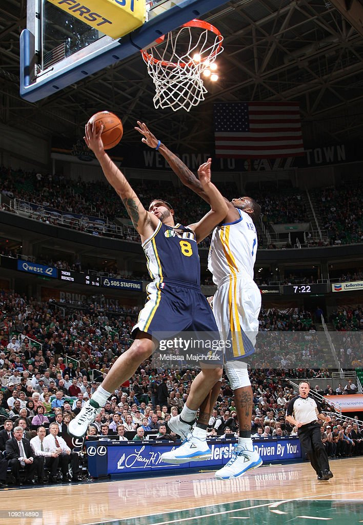 <a gi-track='captionPersonalityLinkClicked' href=/galleries/search?phrase=Deron+Williams&family=editorial&specificpeople=203215 ng-click='$event.stopPropagation()'>Deron Williams</a> #8 of the Utah Jazz lays it up against <a gi-track='captionPersonalityLinkClicked' href=/galleries/search?phrase=Dorell+Wright&family=editorial&specificpeople=211344 ng-click='$event.stopPropagation()'>Dorell Wright</a> #1 of the Golden State Warriors at EnergySolutions Arena on February 16, 2011 in Salt Lake City, Utah.