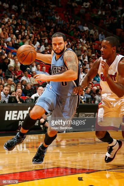 Deron Williams of the Utah Jazz moves the ball against Mario Chalmers of the Miami Heat during the game on December 23 2009 at American Airlines...