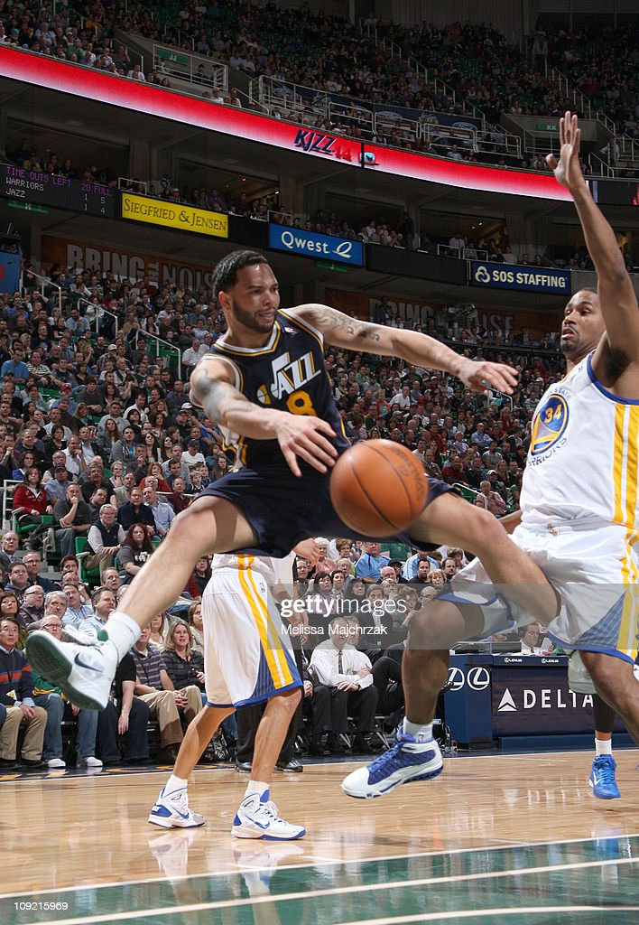 <a gi-track='captionPersonalityLinkClicked' href=/galleries/search?phrase=Deron+Williams&family=editorial&specificpeople=203215 ng-click='$event.stopPropagation()'>Deron Williams</a> #8 of the Utah Jazz passes the ball around <a gi-track='captionPersonalityLinkClicked' href=/galleries/search?phrase=Charlie+Bell&family=editorial&specificpeople=547350 ng-click='$event.stopPropagation()'>Charlie Bell</a> #34 of the Golden State Warriors at EnergySolutions Arena on February 16, 2011 in Salt Lake City, Utah.