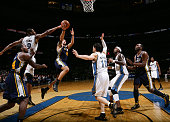 Deron Williams of the Utah Jazz shoots against Rashard Lewis and Kirk Hinrich of the Washington Wizards at the Verizon Center on January 17 2011 in...