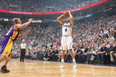 Deron Williams of the Utah Jazz shoots the ball against Derek Fisher of the Los Angeles Lakers in Game Three of the Western Conference Quarterfinals...
