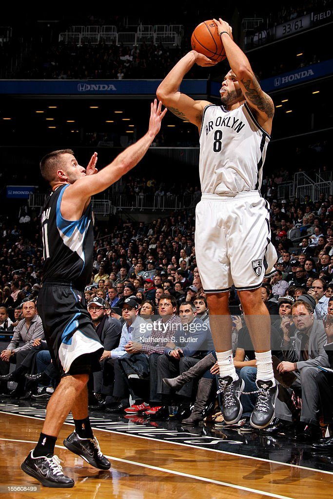 Deron Williams #8 shoots a three-pointer against Jose Juan Barea #11 of the Minnesota Timberwolves on November 5, 2012 at the Barclays Center in Brooklyn, New York.