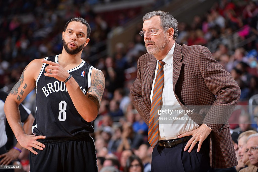 <a gi-track='captionPersonalityLinkClicked' href=/galleries/search?phrase=Deron+Williams&family=editorial&specificpeople=203215 ng-click='$event.stopPropagation()'>Deron Williams</a> #8 speaks to Head Coach <a gi-track='captionPersonalityLinkClicked' href=/galleries/search?phrase=P.J.+Carlesimo&family=editorial&specificpeople=243247 ng-click='$event.stopPropagation()'>P.J. Carlesimo</a> of the Brooklyn Nets against the Philadelphia 76ers at the Wells Fargo Center on March 11, 2013 in Philadelphia, Pennsylvania.