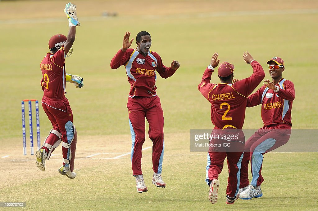 Derone Davis (C) of the West Indies celebrates a wicket with team mates during the ICC U19 Cricket World Cup 2012 Semi Final match between Pakistan and the West Indies at Endeavour Park on August 22, 2012 in Townsville, Australia.