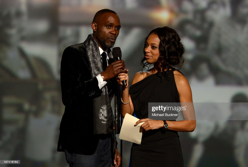 Derreck Kayongo and show host Nischelle Turner speak onstage during the CNN Heroes: An All Star Tribute at The Shrine Auditorium on December 2, 2012 in Los Angeles, California. 23046_006_MB_0202.JPG