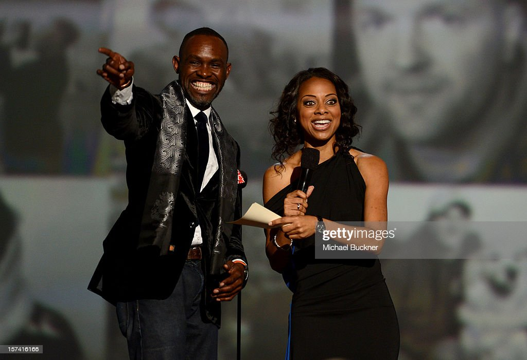 Derreck Kayongo and show host Nischelle Turner speak onstage during the CNN Heroes: An All Star Tribute at The Shrine Auditorium on December 2, 2012 in Los Angeles, California. 23046_006_MB_0193.JPG