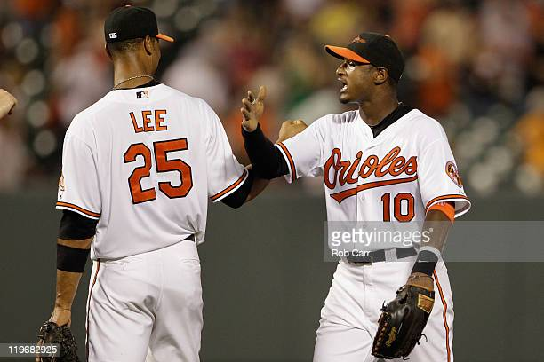 Derrek Lee and teammate Adam Jones of the Baltimore Orioles celebrate the Orioles 32 win over the Los Angeles Angels of Anaheim at Oriole Park at...