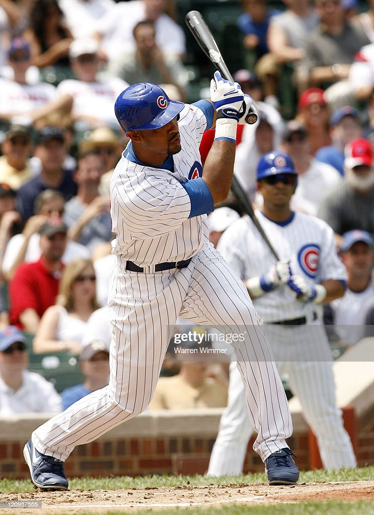Derrek Lee, first baseman of the Chicago Cubs, doubles during the game against the New York Mets at Wrigley Field, Chicago, Illinois on July 14, 2006.
