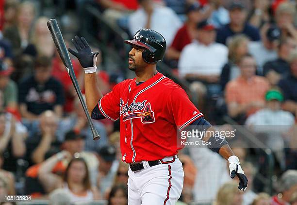 Derrek Lee of the Atlanta Braves reacts after striking out against the San Francisco Giants during Game Three of the NLDS of the 2010 MLB Playoffs at...