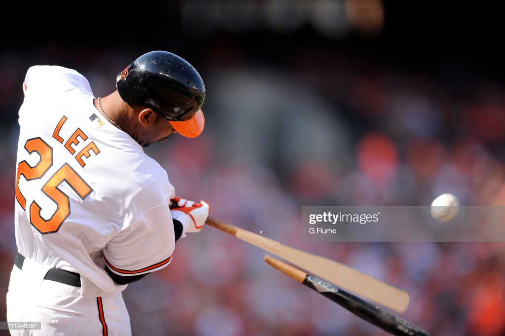 Derrek Lee #25 of the Baltimore Orioles hits a broken bat single in the third inning against the Detroit Tigers on opening day April 4, 2011 at Camden Yards in Baltimore, Maryland.