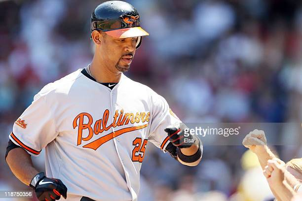 Derrek Lee of the Baltimore Orioles is congratulated after his two run homer in the first inning against the Boston Red Sox on July 10 2011 at Fenway...