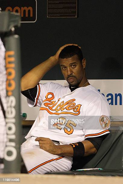 Derrek Lee of the Baltimore Orioles sits in the dugout during the Orioles game against the Boston Red Sox at Oriole Park at Camden Yards on July 18...