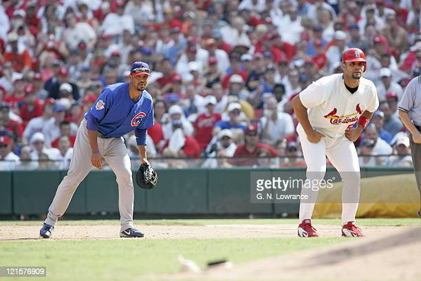 Derrek Lee of the Chicago Cubs and the Cardinals Albert Pujols wait for a pitch during a game against the St Louis Cardinals at Busch Stadium in St...