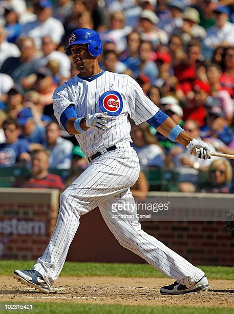Derrek Lee of the Chicago Cubs hits the ball against the Los Angeles Angels of Anaheim at Wrigley Field on June 20 2010 in Chicago Illinois The Cubs...