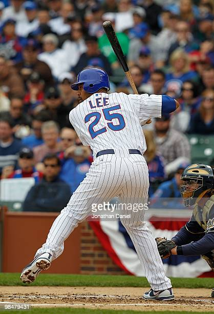 Derrek Lee of the Chicago Cubs prepares to swing against the Milwaukee Brewers on Opening Day at Wrigley Field on April 12 2010 in Chicago Illinois...