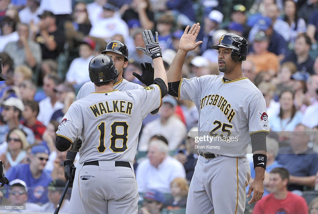 Derrek Lee #25 of the Pittsburgh Pirates congratulates Neil Walker #18 at home plate after Walker hit a two-run home run scoring Lee during the eighth inning against the Chicago Cubs at Wrigley Field on September 4, 2011 in Chicago, Illinois.