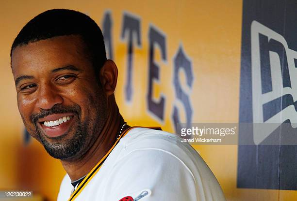 Derrek Lee of the Pittsburgh Pirates newly acquired by trade from the Baltimore Orioles laughs in the dugout during the game against against the...