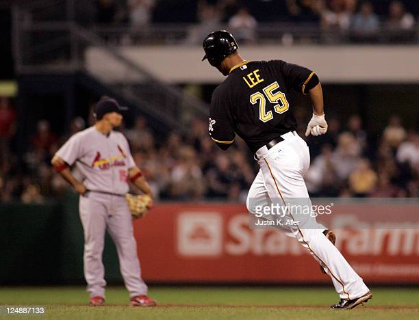 Derrek Lee of the Pittsburgh Pirates rounds second after hitting a solo home run in the third inning against the St Louis Cardinals during the game...