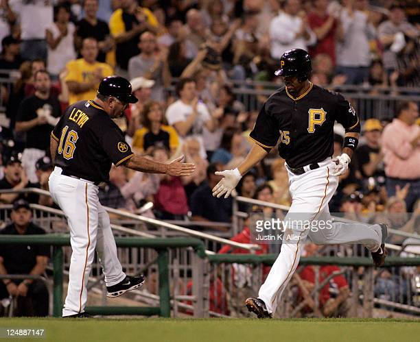 Derrek Lee of the Pittsburgh Pirates rounds third after hitting a solo home run in the third inning against the St Louis Cardinals during the game on...