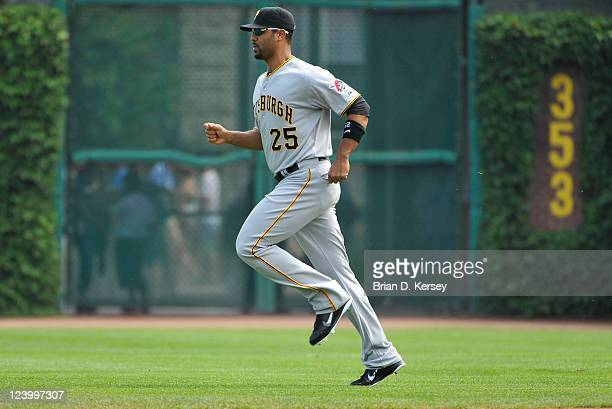 Derrek Lee of the Pittsburgh Pirates warms up before the game against of the Chicago Cubs at Wrigley Field on September 3 2011 in Chicago Illinois...