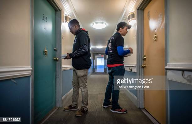 Derrick Aikens left and Azariah Sheth knock on doors as they deliver lunches Gonzaga High School students fulfill their service learning requirements...