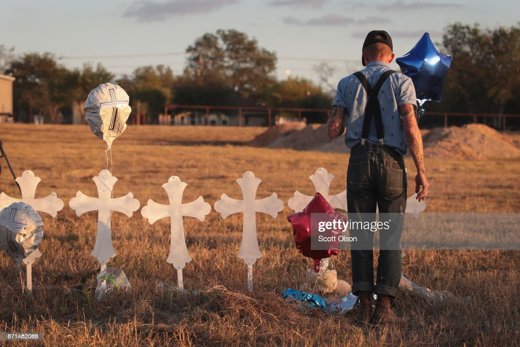Derrick Bernaden of San Antonio, Texas visits a memorial where 26 crosses stand in a field on the edge of town to honor the 26 victims killed at the First Baptist Church of Sutherland Springs on November 7, 2017 in Sutherland Springs, Texas. On November 5, a gunman, Devin Patrick Kelley, shot and killed the 26 people and wounded 20 others when he opened fire during a Sunday service.