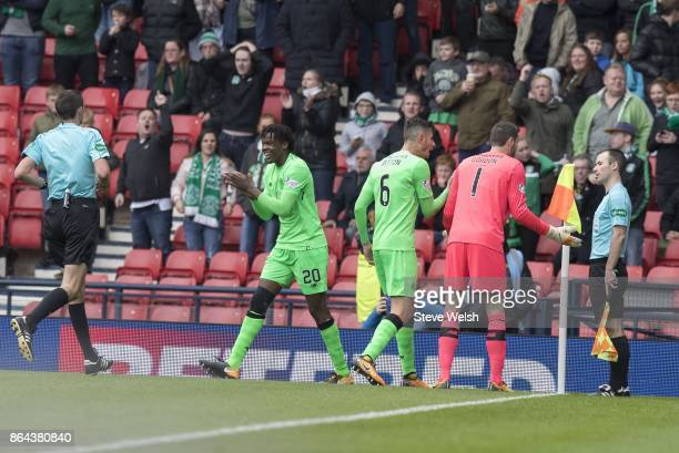 Derrick Boyata of Celtic goes towards the Ref as Celtic Players race towards the Linesman Ref has given a Penalty to Hibs during the Betfred Cup...