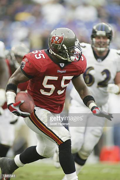Derrick Brooks of the Tampa Bay Buccaneers returns an interception 97 yards for a touchdown against the Baltimore Ravens on September 15 2002 at...