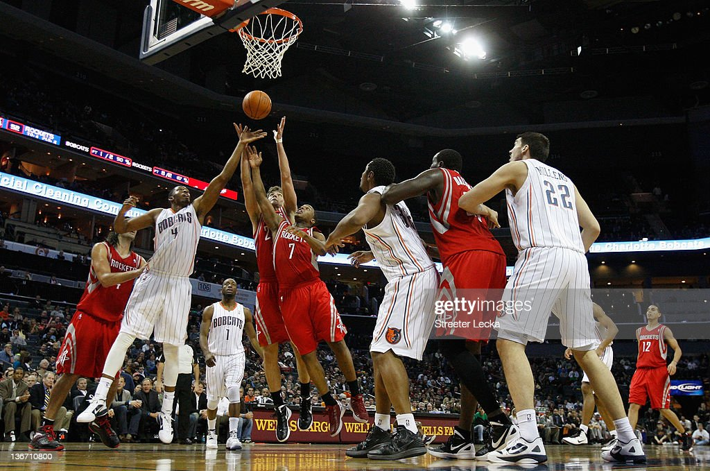 Derrick Brown #4 of the Charlotte Bobcats battles for a loose ball with Chandler Parsons #25 and teammate <a gi-track='captionPersonalityLinkClicked' href=/galleries/search?phrase=Kyle+Lowry&family=editorial&specificpeople=714625 ng-click='$event.stopPropagation()'>Kyle Lowry</a> #7 of the Houston Rockets during their game at Time Warner Cable Arena on January 10, 2012 in Charlotte, North Carolina.