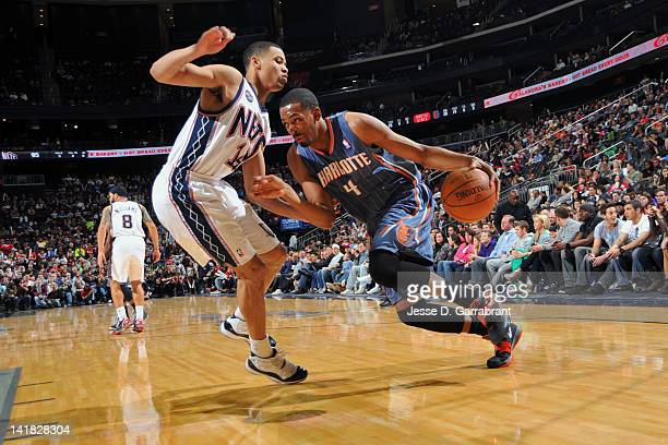 Derrick Brown of the Charlotte Bobcats drives to the basket Gerald Green of the New Jersey Nets on March 24 2012 at the Prudential Center in Newark...