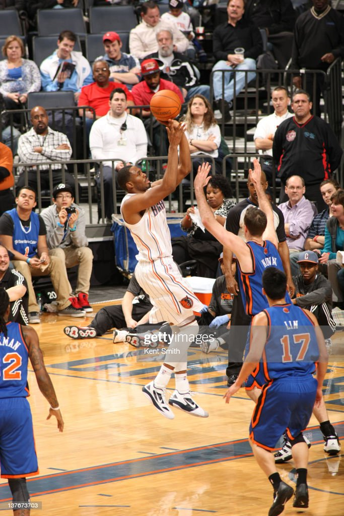 Derrick Brown #4 of the Charlotte Bobcats shoots against <a gi-track='captionPersonalityLinkClicked' href=/galleries/search?phrase=Steve+Novak&family=editorial&specificpeople=693015 ng-click='$event.stopPropagation()'>Steve Novak</a> #16 of the New York Knicks during the game at the Time Warner Cable Arena on January 24, 2012 in Charlotte, North Carolina.