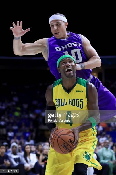 Derrick Byars of the Ball Hogs attempts a shot while being guarded by Mike Bibby of the Ghost Ballers during week three of the BIG3 three on three...
