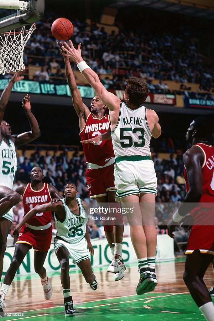 Derrick Chievous #3 of the Houston Rockets shoots a layup against Joe Kleine #53 of the Boston Celtics during a game played in 1990 at the Boston Garden in Boston, Massachusetts.