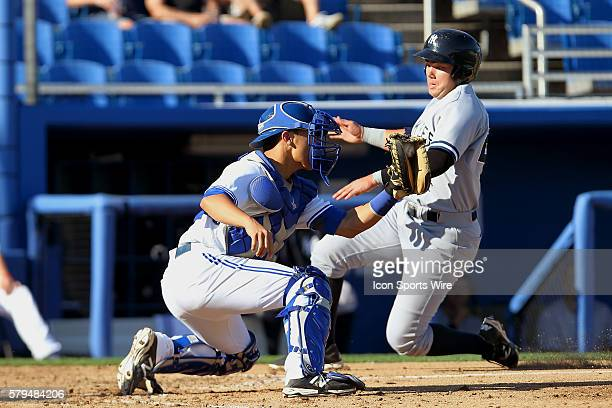 Derrick Chung of the Blue Jays fields the throw to the plate as Dante Bichette Jr of the Yankees scores ahead of the tag during the Florida State...