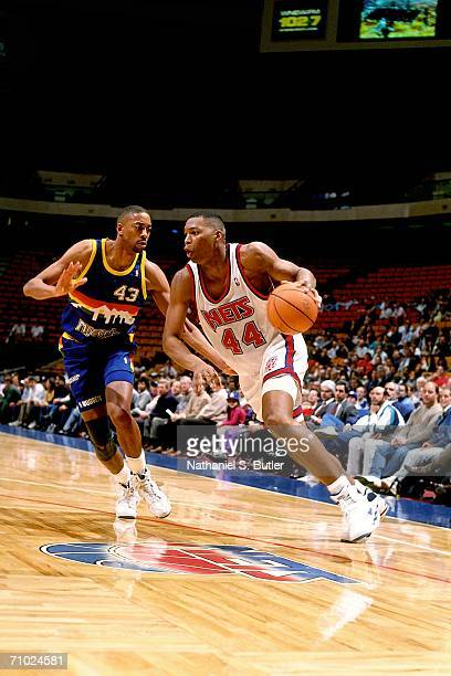 Derrick Coleman of the New Jersey Nets drives to the basket against Michael Williams of the Indiana Pacers during a game played in 1991 at the...