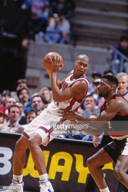 Derrick Coleman of the New Jersey Nets posts up against the Portland Trail Blazers during a game played circa 1993 at the Brendan Byrne Arena in East...