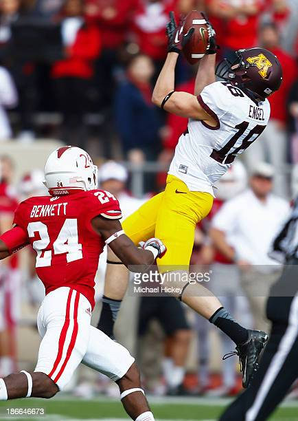 Derrick Engel of the Minnesota Golden Gophers goes up to catch a pass as Tim Bennett of the Indiana Hoosiers defends at Memorial Stadium on November...