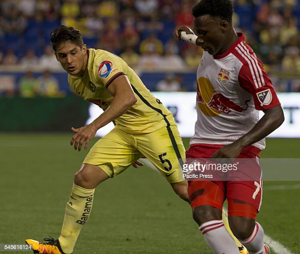 Derrick Etienne of New York Red Bulls Javier Guemez of Club America of Liga MX Mexico fight for ball during friendly game at Red Bull arena Red Bulls...