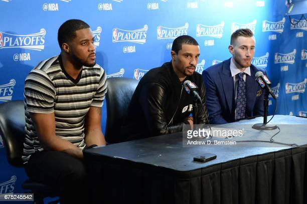 Derrick Favors George Hill and Gordon Hayward of the Utah Jazz speak to the media after Game Seven of the Western Conference Quarterfinals of the...