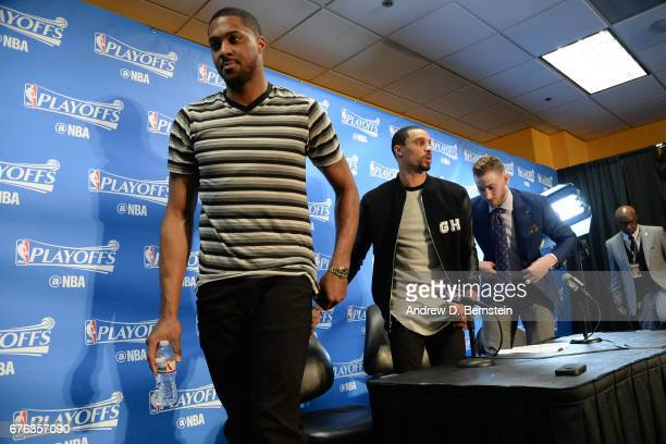 Derrick Favors George Hill and Gordon Hayward of the Utah Jazz walk off the stage after a press conference after Game Seven of the Western Conference...
