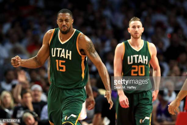 Derrick Favors gestures as Gordon Hayward of the Utah Jazz looks on during the second half of Game Seven of the Western Conference Quarterfinals...
