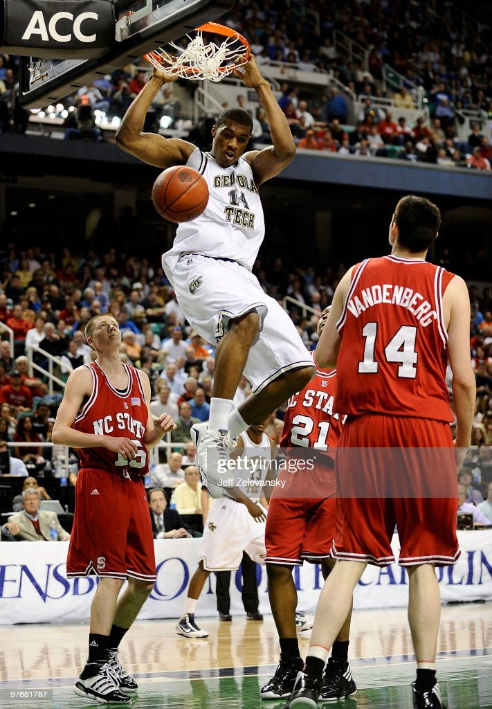 Derrick Favors of the Georgia Tech Yellow Jackets dunks against Scott Wood CJ Williams and Jordan Vandenburg of the North Carolina State Wolfpack in...