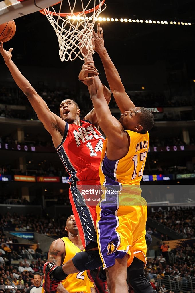 Derrick Favors of the New Jersey Nets goes up for a shot against Andrew Bynum of the Los Angeles Lakers at Staples Center on January 14 2011 in Los...