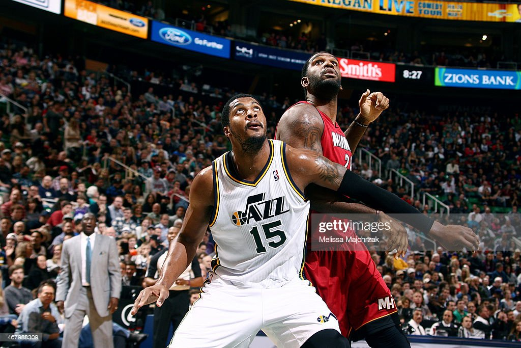 Derrick Favors of the Utah Jazz and Greg Oden of the Miami Heat look for a rebound at EnergySolutions Arena on February 08 2014 in Salt Lake City...