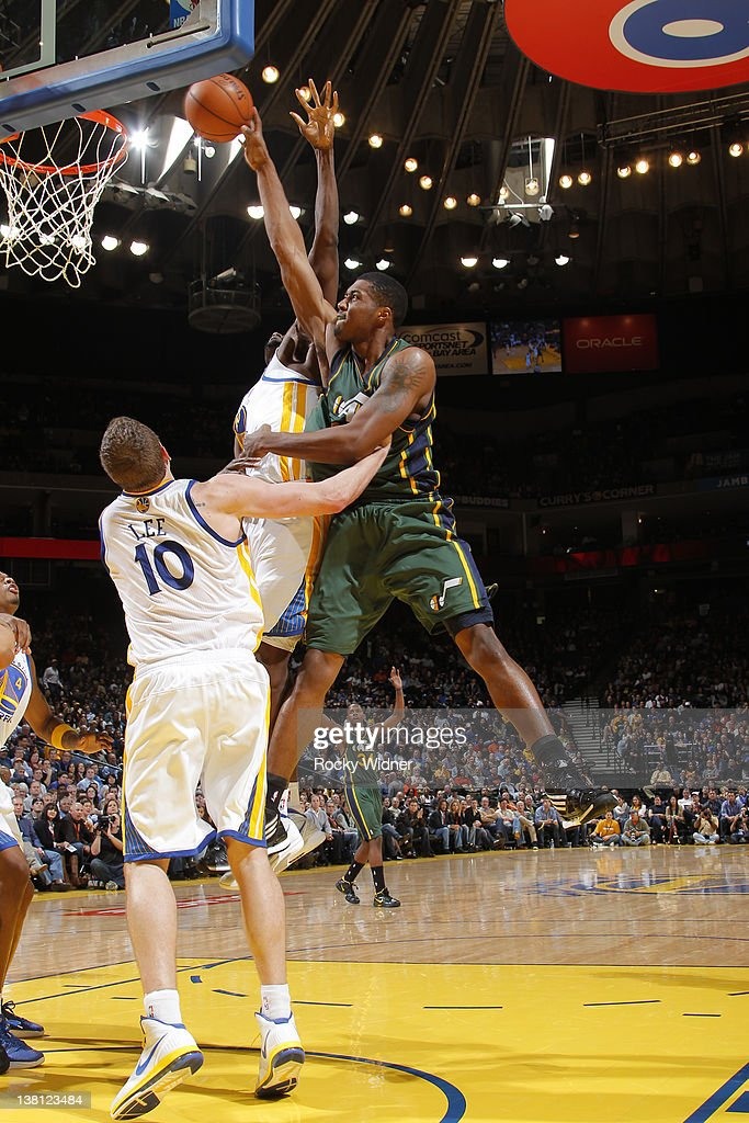 <a gi-track='captionPersonalityLinkClicked' href=/galleries/search?phrase=Derrick+Favors&family=editorial&specificpeople=5792014 ng-click='$event.stopPropagation()'>Derrick Favors</a> #15 of the Utah Jazz attempts to dunk the ball over <a gi-track='captionPersonalityLinkClicked' href=/galleries/search?phrase=Ekpe+Udoh&family=editorial&specificpeople=4185351 ng-click='$event.stopPropagation()'>Ekpe Udoh</a> #20 and David Lee #10 of the Golden State Warriors on February 2, 2012 at Oracle Arena in Oakland, California.