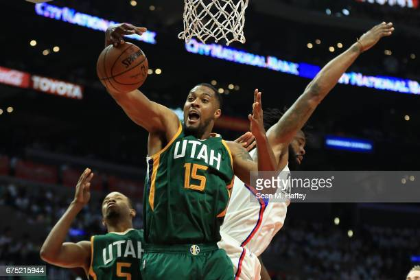 Derrick Favors of the Utah Jazz battles DeAndre Jordan of the Los Angeles Clippers for a rebound during the first half of Game Seven of the Western...