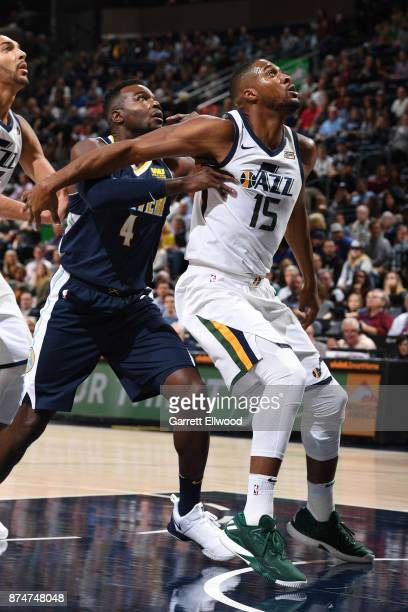 Derrick Favors of the Utah Jazz boxes out Paul Millsap of the Denver Nuggets during the game on October 18 2017 at vivintSmartHome Arena in Salt Lake...